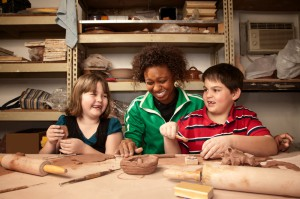 Kids and teacher working with clay