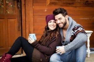 couple enjoying a cup of coffee at a Smoky Mountain cabin rental