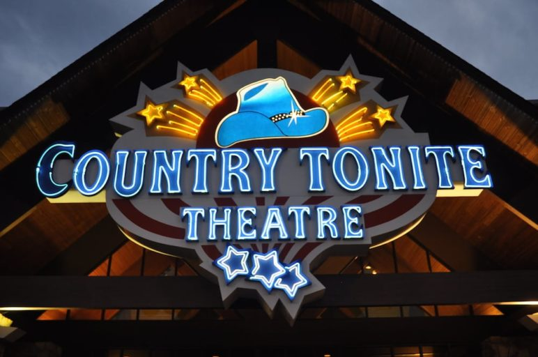 Country Tonite music show in Pigeon Forge sign at night