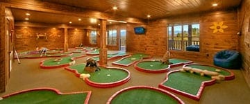 A mini golf course inside of a cabin rental in the Smoky Mountains.