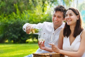 Couple enjoying a glass of wine near our romantic Smoky Mountain cabins.