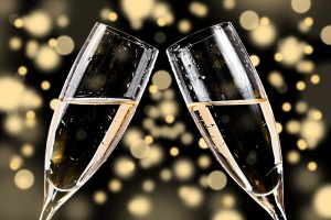 Clinking flutes of champagne for New Year's Eve.