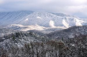 Stunning photo of the mountains near Pigeon Forge covered in snow.