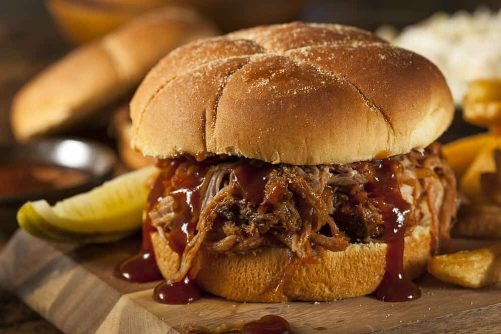 A pulled pork sandwich with BBQ sauce.
