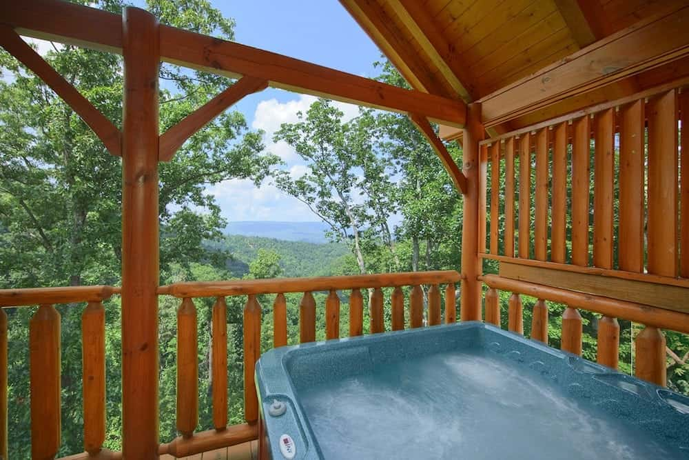 Hot tub on the deck of the High Timber Retreat cabin.