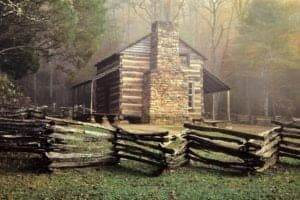The John Oliver cabin behind a fence in Cades Cove.
