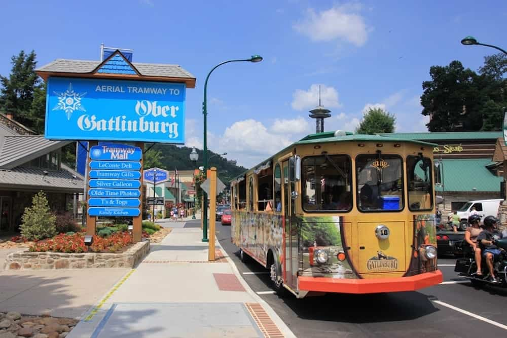 Gatlinburg trolley in front of Ober Gatlinburg sign