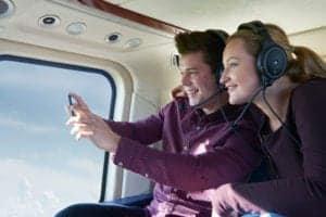 couple taking a scenic helicopter tour in pigeon forge