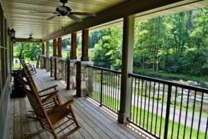 deck of a cabin by the river